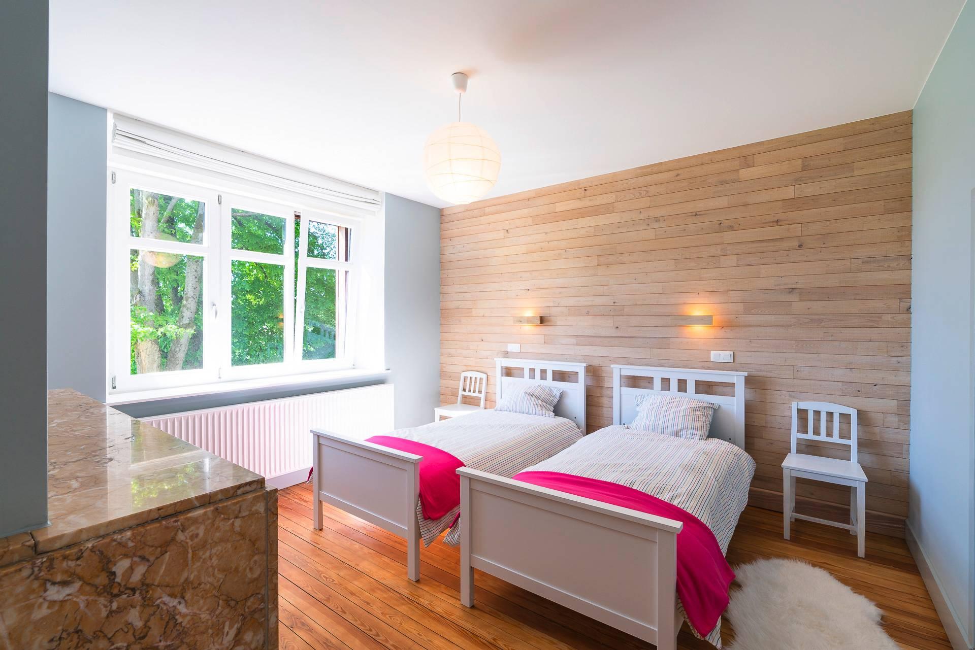 chambre claire deux lits séparés